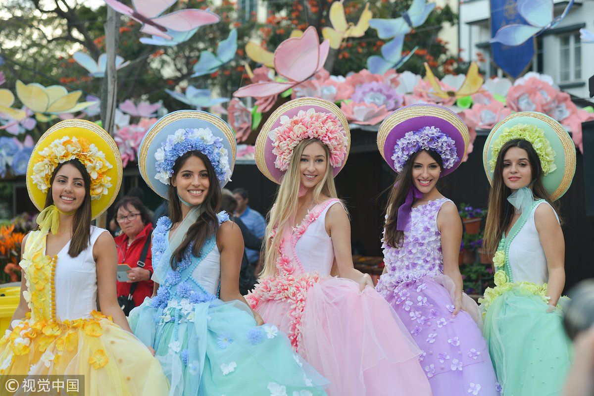 People in the #Portuguese island of #Madeira in the Atlantic mark the Flower Festival, a celebration of spring, fertility and rebirth, by wearing floral dresses and hats and performing traditional dances