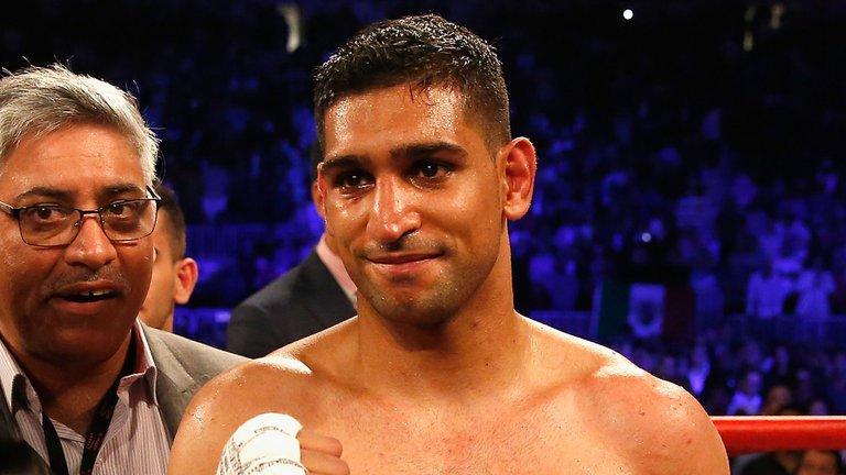BREAKING: Amir Khan beats Phil Lo Greco...