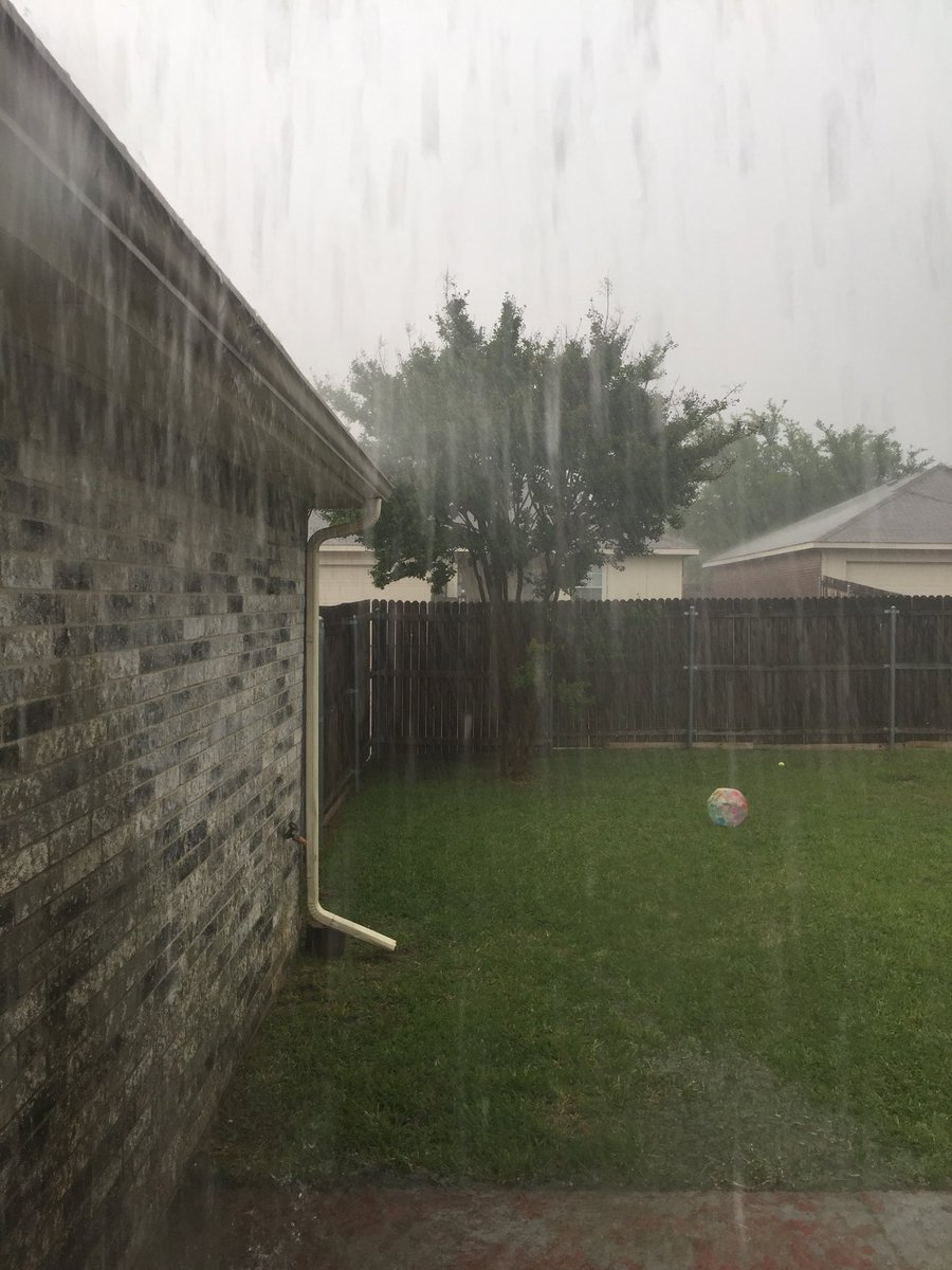 @wfaaweather #Downpour in South Arlington! Granddaughter's ball floating around in the backyard  No fuss, we need the rain! <br>http://pic.twitter.com/dMiXzEf7J8