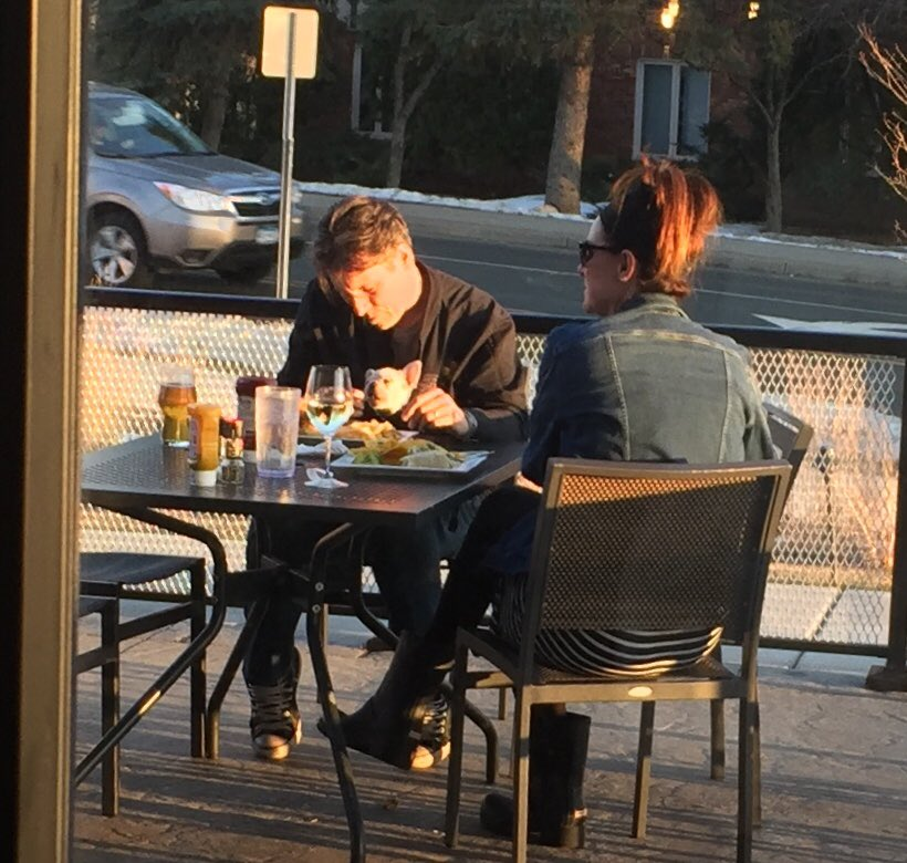 this guy snuck his puppy frenchie in his coat and is feeding him fries... he keeps that mf ᵗʰᵃᶰᵍ on him