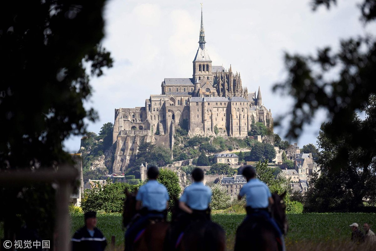 #French tourist site Mont-Saint-Michel evacuated after an unidentified man threatened to attack policemen, according to local media (File pic)
