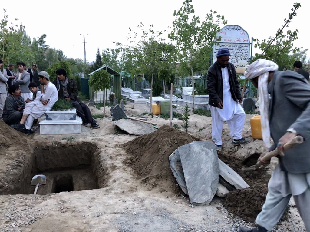 As the sun dissolved into the huge clouds over Kabul mountains this evening, many around the city were digging graves. 52 graves, from what we know so far. In this one, a champion went to rest.