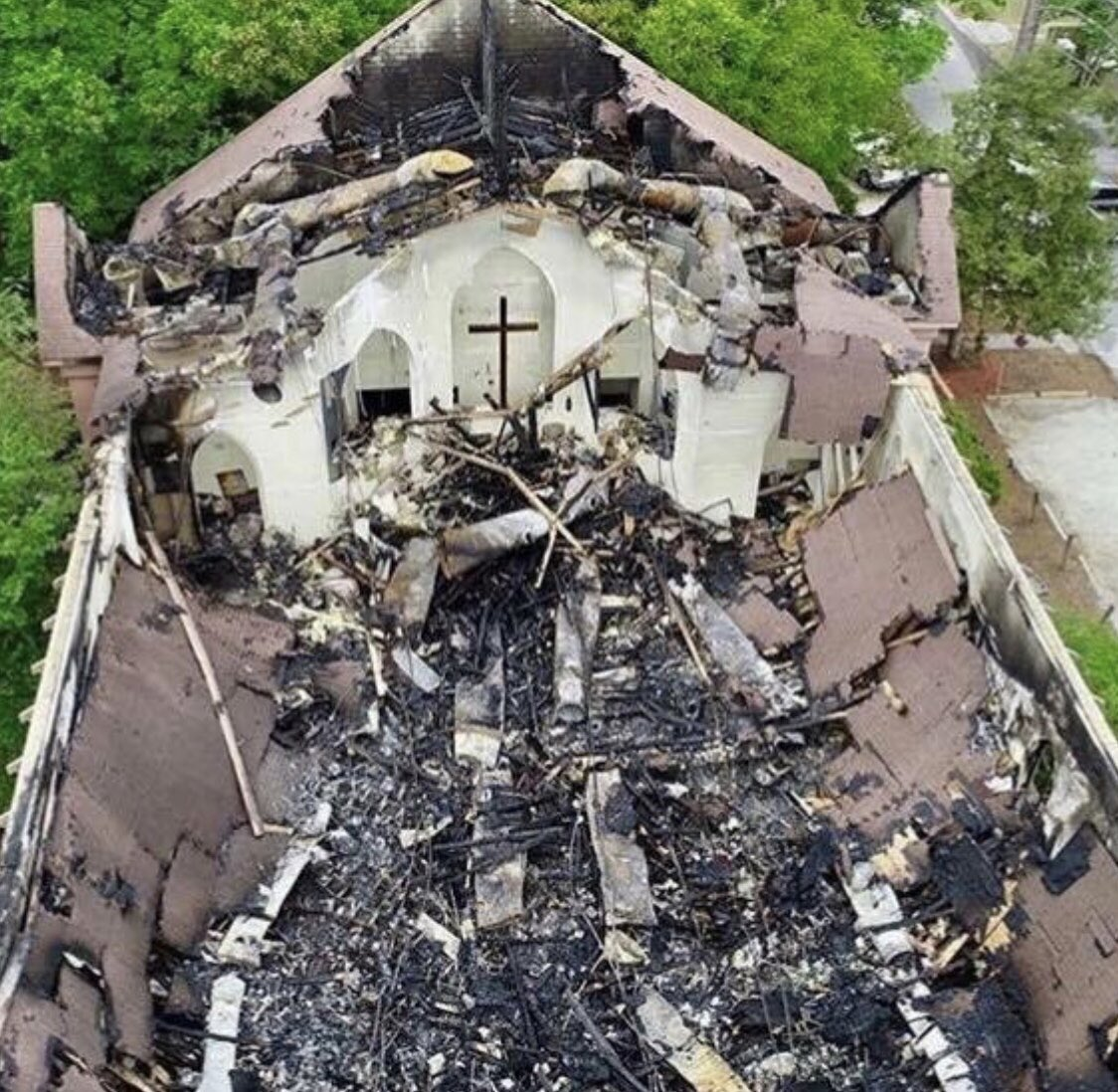 "My sister's beautiful church burned today. Look what remains!  The cross stands always and forever. The pastor says, ""The Lord promises to bring beauty out of ashes."" @FoxNews @foxandfriends"