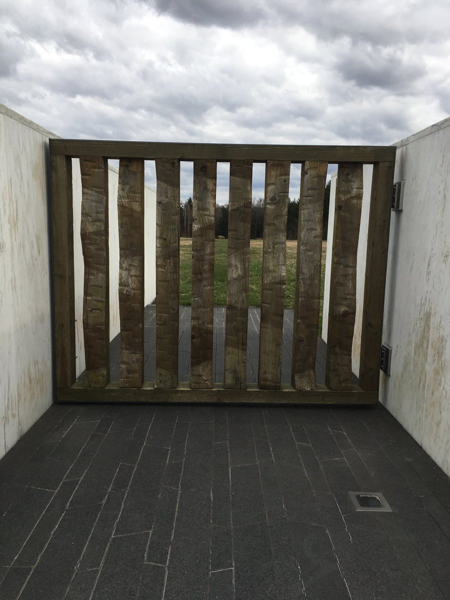 One of the more striking things at the Flight 93 Memorial in Shanksville, Pa.: The gate at the end of the Wall of Names of the victims leading to the crash site (marked by the boulder in the distance).