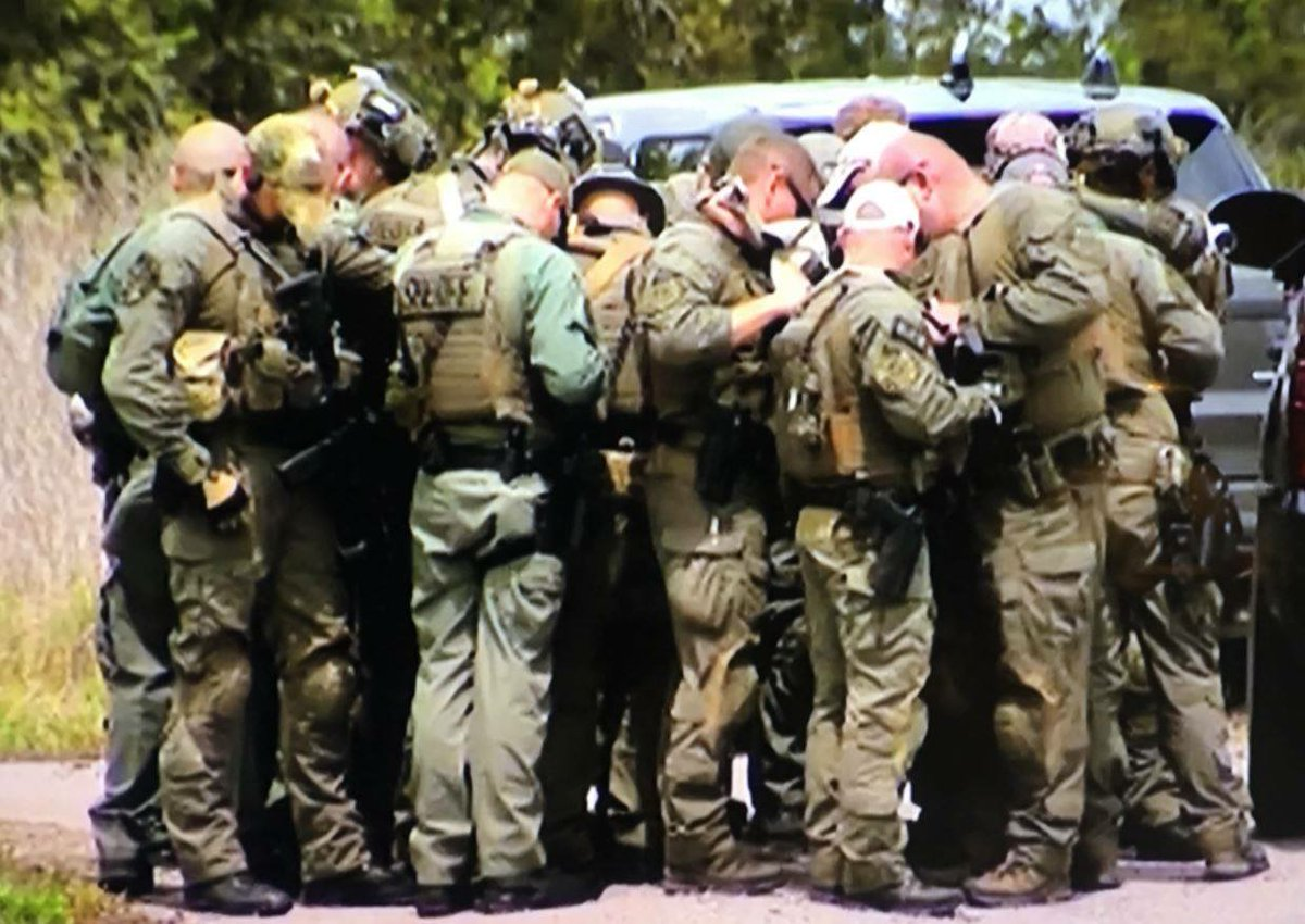 PHOTO: Rutherford County, Tenn. Sheriff's SWAT Team members take a moment to pray before joining the search for Waffle House murder suspect Travis Reinking Monday in Nashville. Metro Police took Reinking into custody shortly after RCSO's SWAT team arrived.