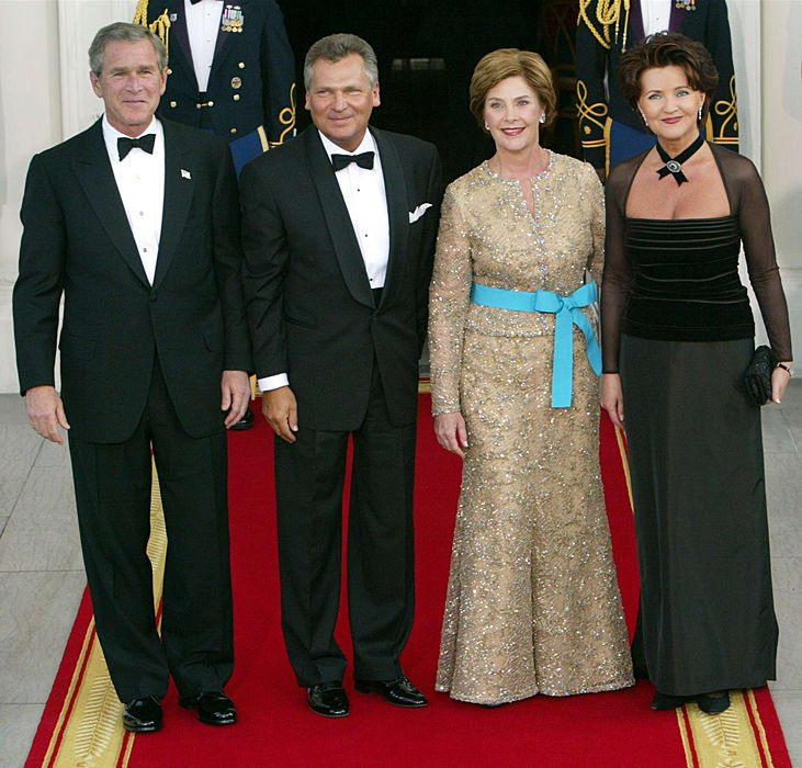 First Ladies shine at State Dinners. Laura Bush and husband as they honor Polish President and Mrs. Kwasniewski, July 18, 2002