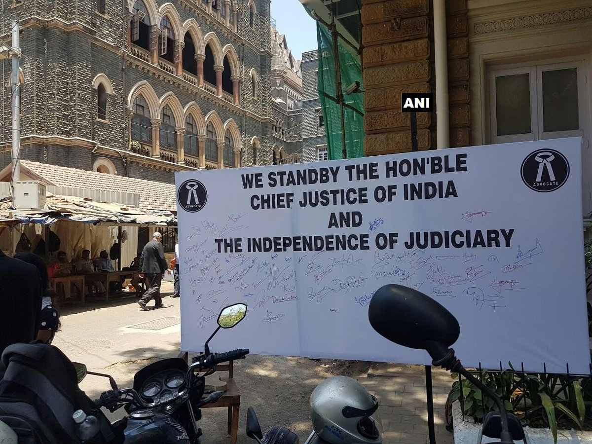 A group of lawyers start a signature campaign outside Bombay High Court in support of Chief Justice of India Dipak Misra.