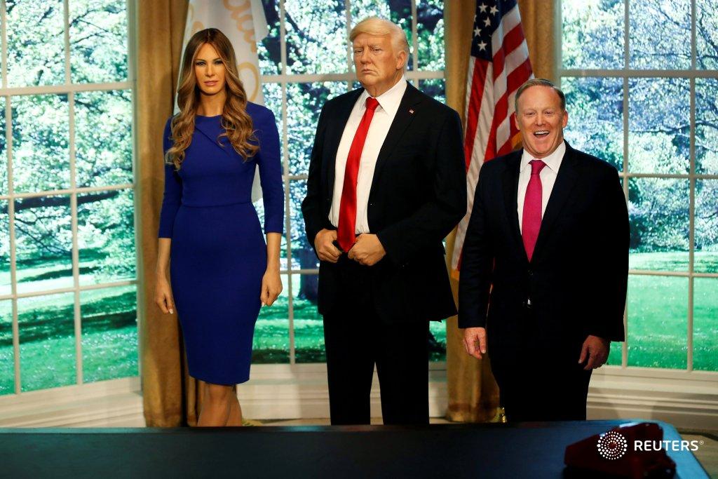 Former White House Press Secretary Sean Spicer poses next to wax figures of  President Donald Trump and first lady Melania Trump. Photo Mike Segar:  image via ...