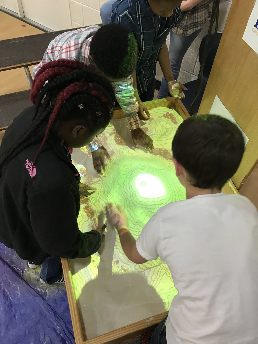 STEM Night at S.W. Snowden Elementary was a hit! The children had a blast playing with the Augmented Reality Sandbox! Part of the IMAGINE-NC Summer STEM Camp! @amays_bwfund @STEMEast @STEMecosystems @ncstem #scicomm <br>http://pic.twitter.com/9mLOAVtX9d