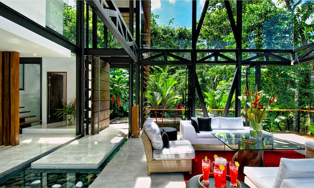 Modern luxury architecture set in a rustic jungle forest, dont you want to experience this?