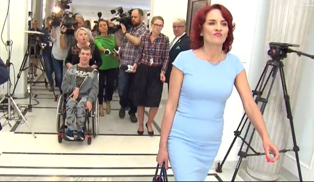 Iconic photo of PiS MP walking away from disabled protesters in parliament after refusing to talk to them