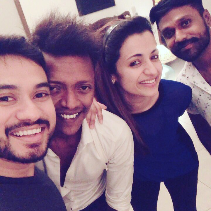 12 latest clicks of Trisha having some