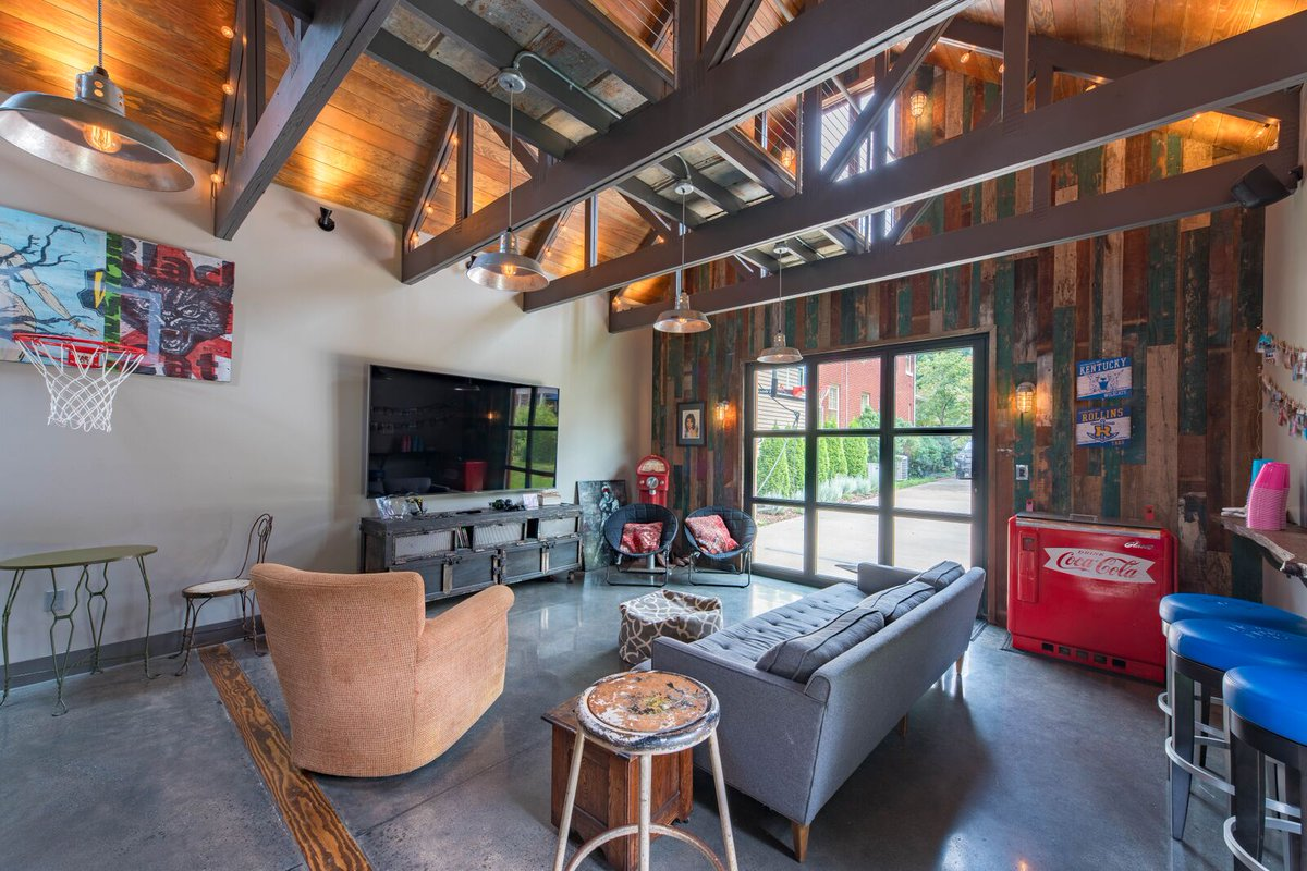 Pohl rosa pohl on twitter a glass roll up door exposed trusses allow abundant natural light in a prp design conversion of garage into rec room