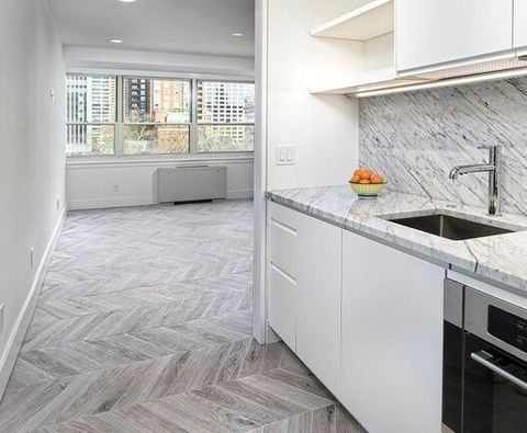 This Great Design By Alonseltzer Features Nemo Tile Baroque In Gris The Chevron Pattern Helps Room Ear Larger Making It Perfect For Apartment