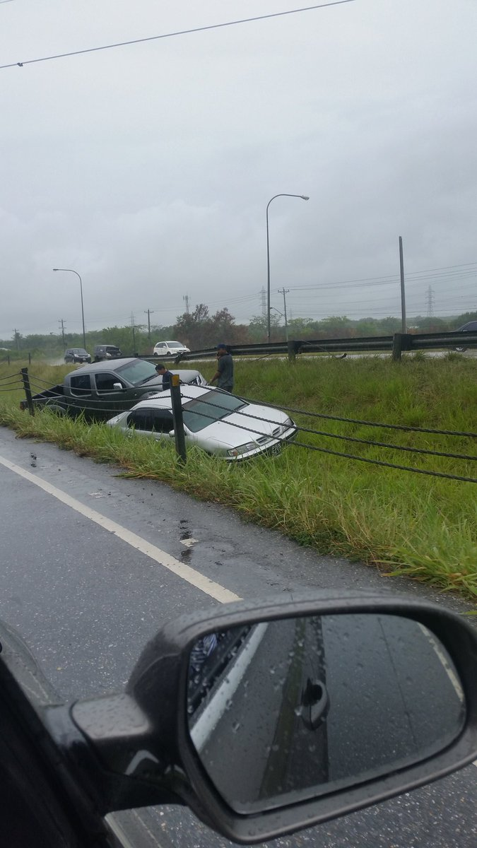 "Afra Raymond on Twitter: ""Two vehicles skidded off the northbound lane of the Uriah Butler Highway in very rainy conditions...about 3.39pm...… """