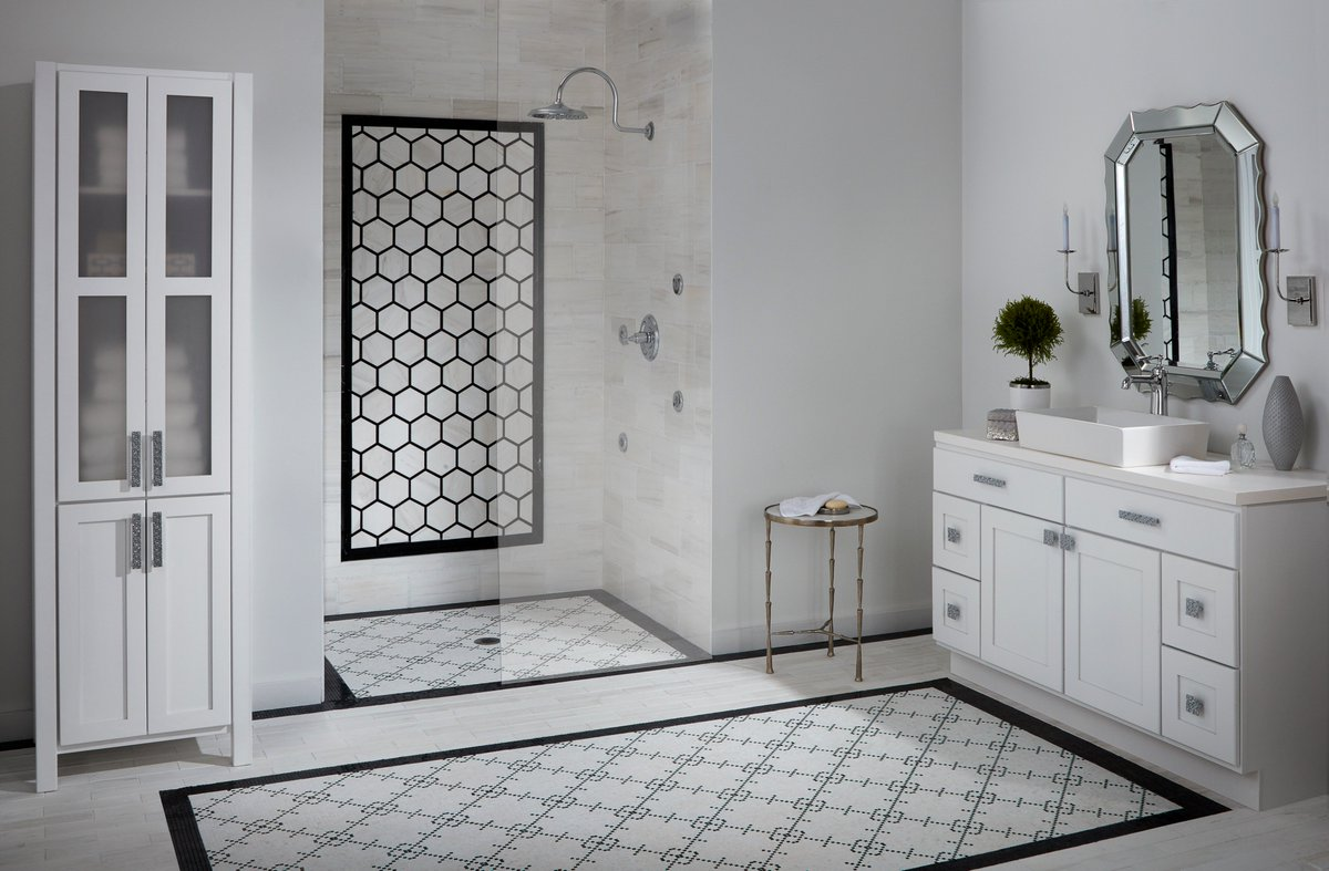 When it's time for an upgrade in the master bath, using black and white patterns and geometric shapes will help you achieve a retro farmhouse vibe! #retroinspired #blackandwhitetile #marble #naturalstone #patternedtile #masterbathupgrade #masterbath #reno #shapes #farmhouse
