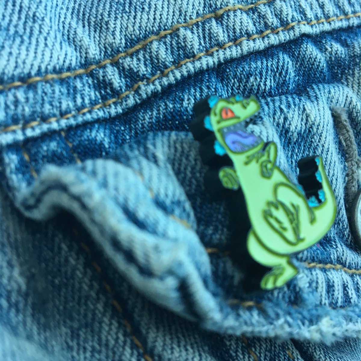 I will share that I went to the comic book store and got this rugrats pin.