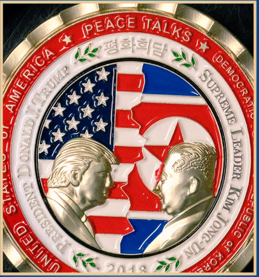 Why is the US flag ripped in half on this coin?