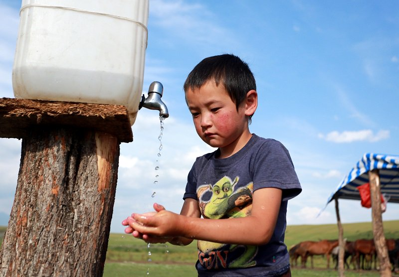 A boy in a nomadic camp in the Suusamyr Valley, Kyrgyzstan. Photo: EPA