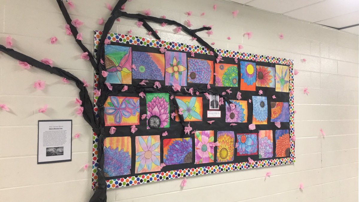Asian Heritage Month bulletin board display with a splash of #GeorgiaOkeeffe inspired flowers. #CherryBlossomTree @rjlee_ps pic.twitter.com/3vLoSrHbBx