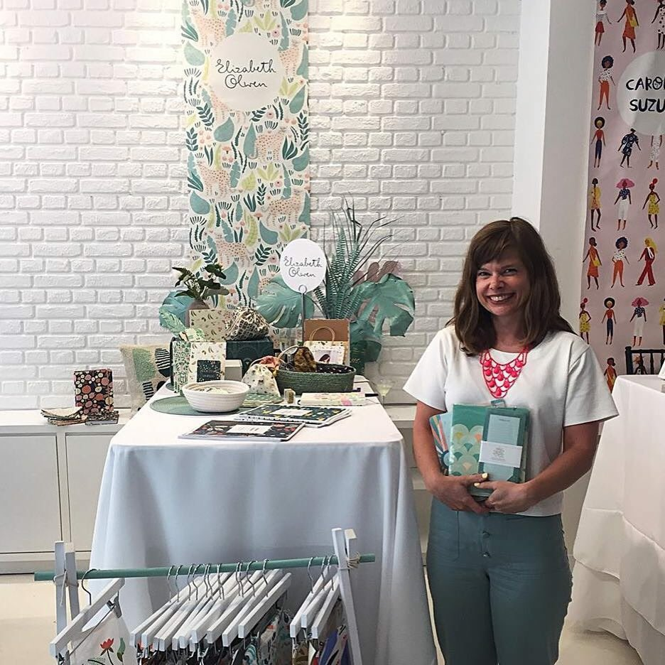 We had a great time in NYC at  #NSS #stationeryshow #surtex2018, @blueprintshows and @fieldtrip! 😊 It's fun to connect in person with artists & agents we work with. Here's @elizabetholwen holding her 2019 #highnotecollecton products in front of her #fieldtrip table. #paperlove