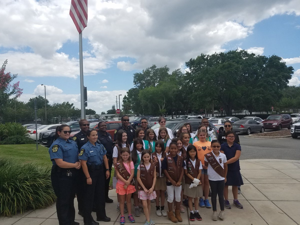 Today, members of Girl Scouts troops 533 and 422 came to the Southeast Community Police Office to help us retire old glory. They then raised a new flag and met with our officers.