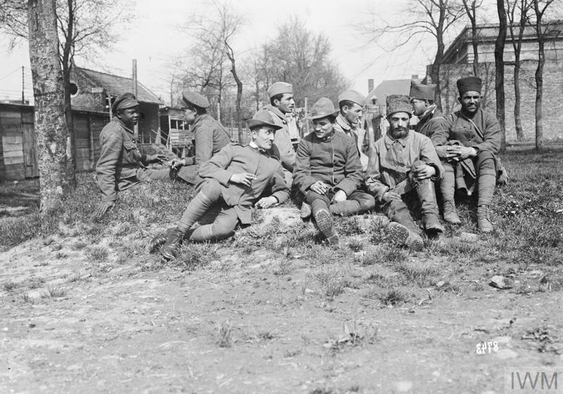 May 1918 - Group of Allied prisoners in a German POW camp near Albert, in northern France. There are British (one of them a black colonial soldier), French, Russian, and Italian prisoners present. #100yearsago
