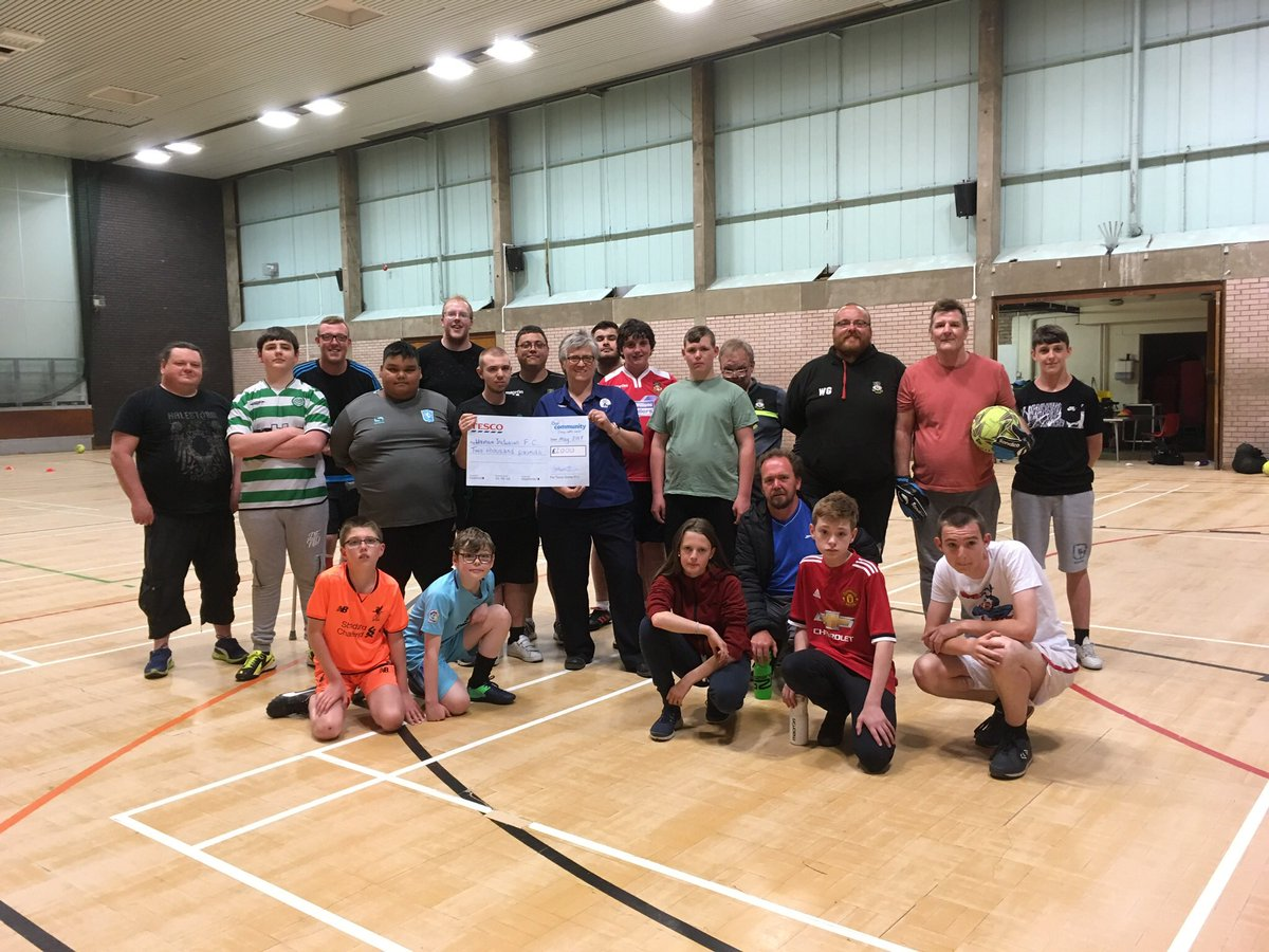 A presentation to members of Wrexham Inclusion Football Club.  The club were awarded second prize in our Bags of Help scheme, winning them £2000 towards their Build the Bus project. @cefnagent @Tesco_Wales @tescocefnmawr @PlasMadocLC<br>http://pic.twitter.com/QF6U0b4t94