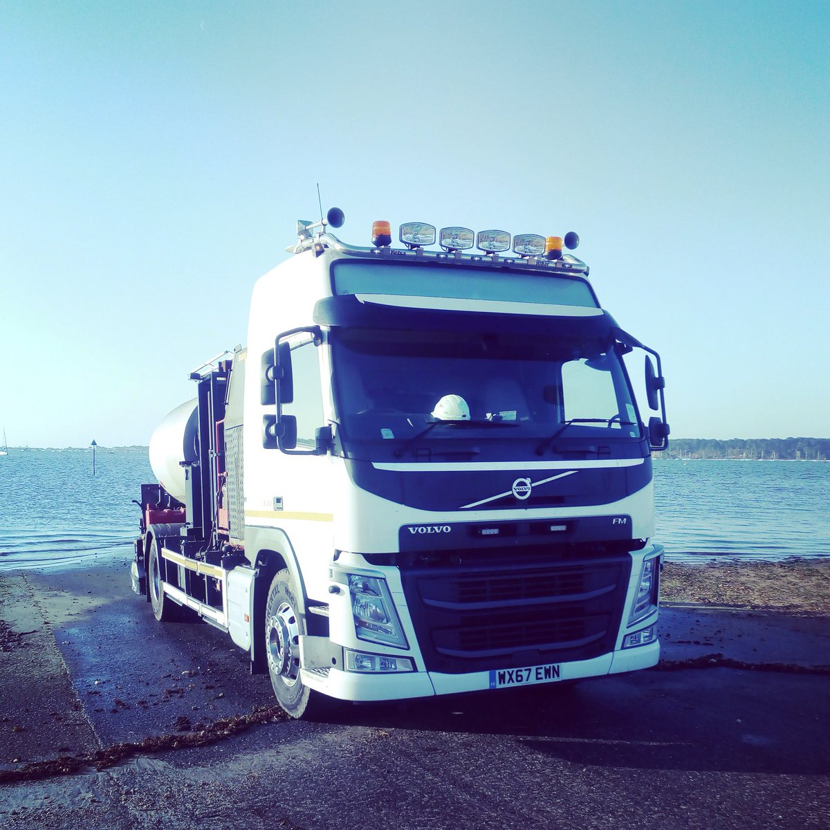 Our Driver sent us this great shot of one of our Tanker Sprayers at #Pooleharbour @VolvoTrucksUK  #RoadConstruction #volvo #trucker #Poole<br>http://pic.twitter.com/ixlngIts4L