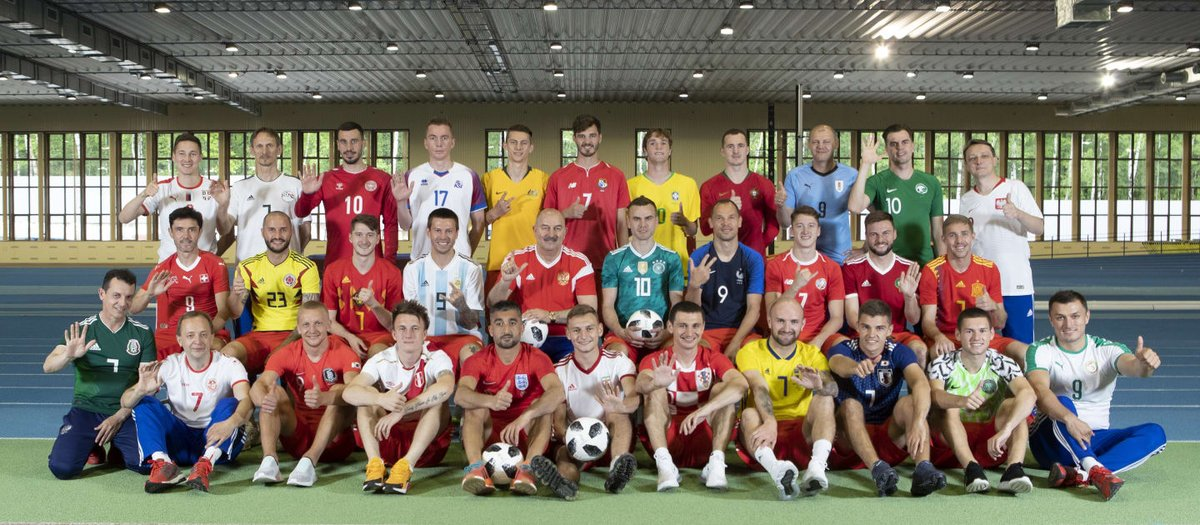 The Russia squad, players and staff, wear a kit from each nation set to compete at the 2018 @FIFAcom World Cup.  What a collection. 😍