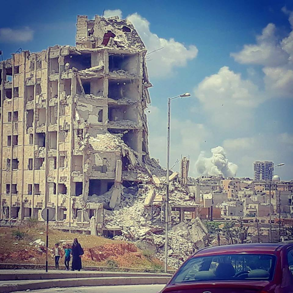 Aleppo-city today. In background airstrikes on Rebel-held Zahraa district.