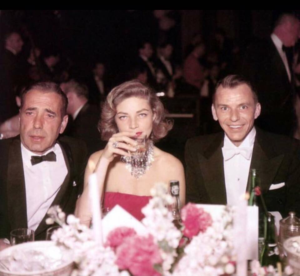 Frank Sinatra passed away exactly twenty years ago today. Here are four great photos of a young Frank with original Rat Pack leader Humphrey Bogart and Lauren Bacall, who is the one who gave the legendary group of drinking buddies its name!