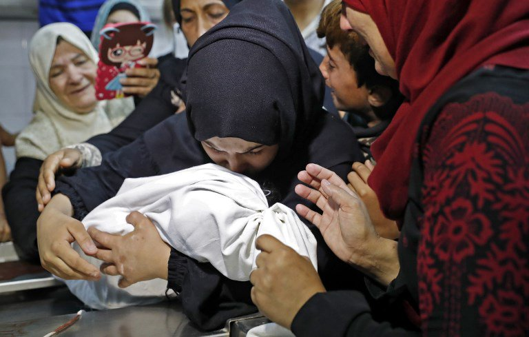 A funeral is taking place for an 8-month-old Palestinian baby who died after Israel fired tear gas into Gaza.