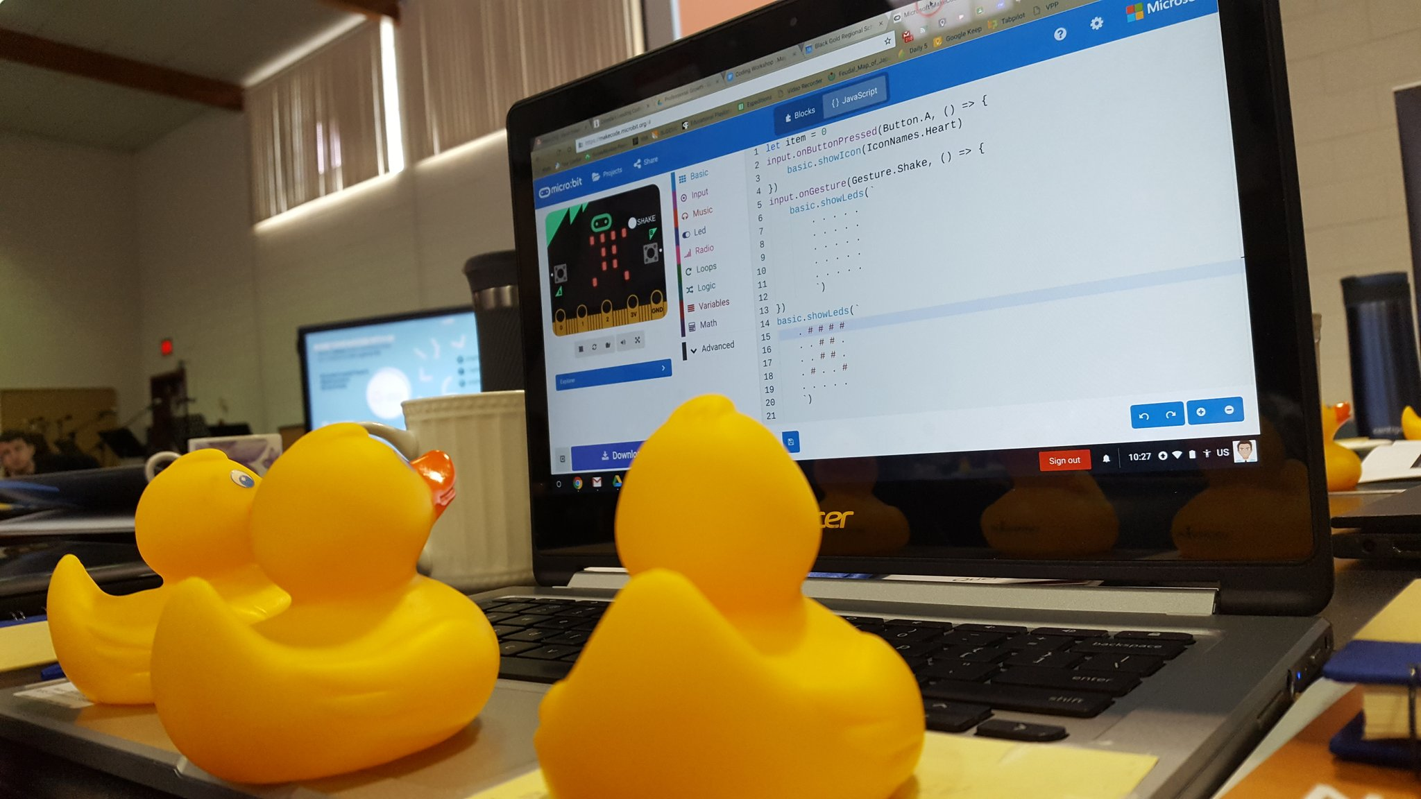 3 rubber ducks in front of a computer