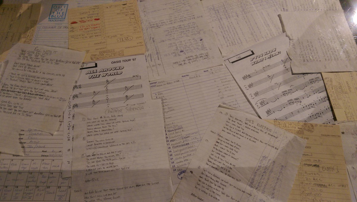 Handwritten lyric sheets, including Roll With It, All Around The World and Shes Electric, displayed at the London, Tokyo and Manchester at Oasis exhibitions.