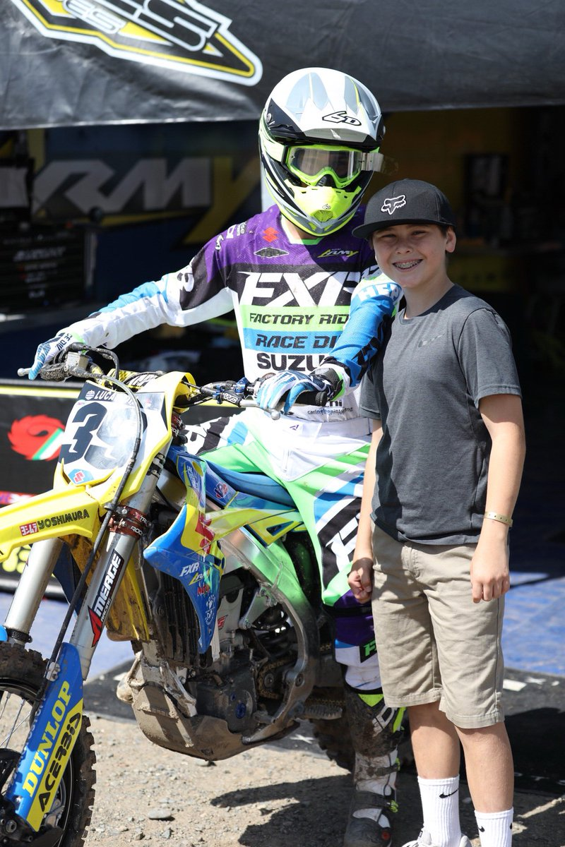 @KCunningham_45 gettin one pic with a fan before heading out to moto one! @suzukicycles @FXRRacing @amptires @NutUpIndustries @ProMotocross #RmArmy #thisismoto #moto #motocross