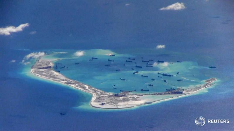 China air force lands bombers on South China Sea island https://t.co/quwvbMhb0a https://t.co/rulHIzEiV0