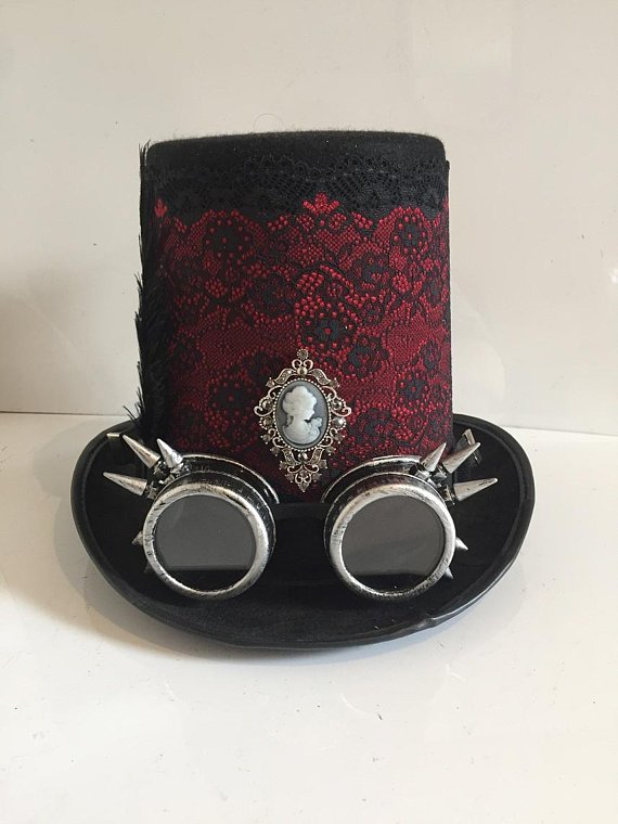 #Steampunk Style Black Felted Wool Stove Pipe Top Hat With Detachable Goggles, Feathers, Lace Trim And Vintage Cameo Style Brooch.   #SNRTG #craftbuzz #flockbn #atsocialmedia #sbutd #eshopsuk   https://t.co/IugLUuEF6o
