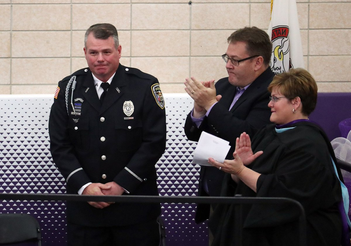 On Sunday, Officer Mark Dallas was honored during the graduation ceremony at Dixon High School for stopping a former student armed with a rifle who attempted to enter the school last week  https:// trib.in/2x7IKTx  &nbsp;   (photos by @briancassella)<br>http://pic.twitter.com/j41Boj2CH2
