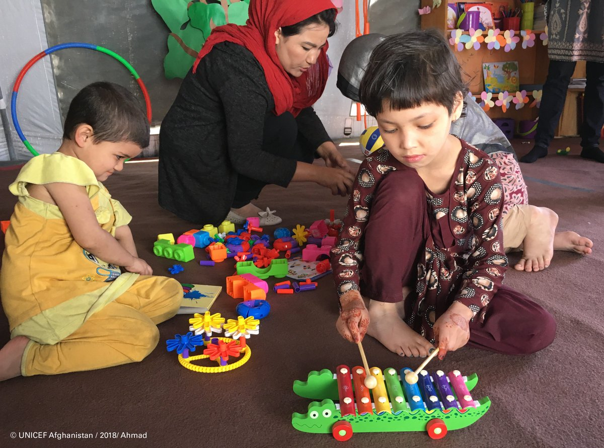 Little Sana and her friends enjoying some music and playtime in a child friendly space in #Kabul.   #ForEveryChild, play 💙