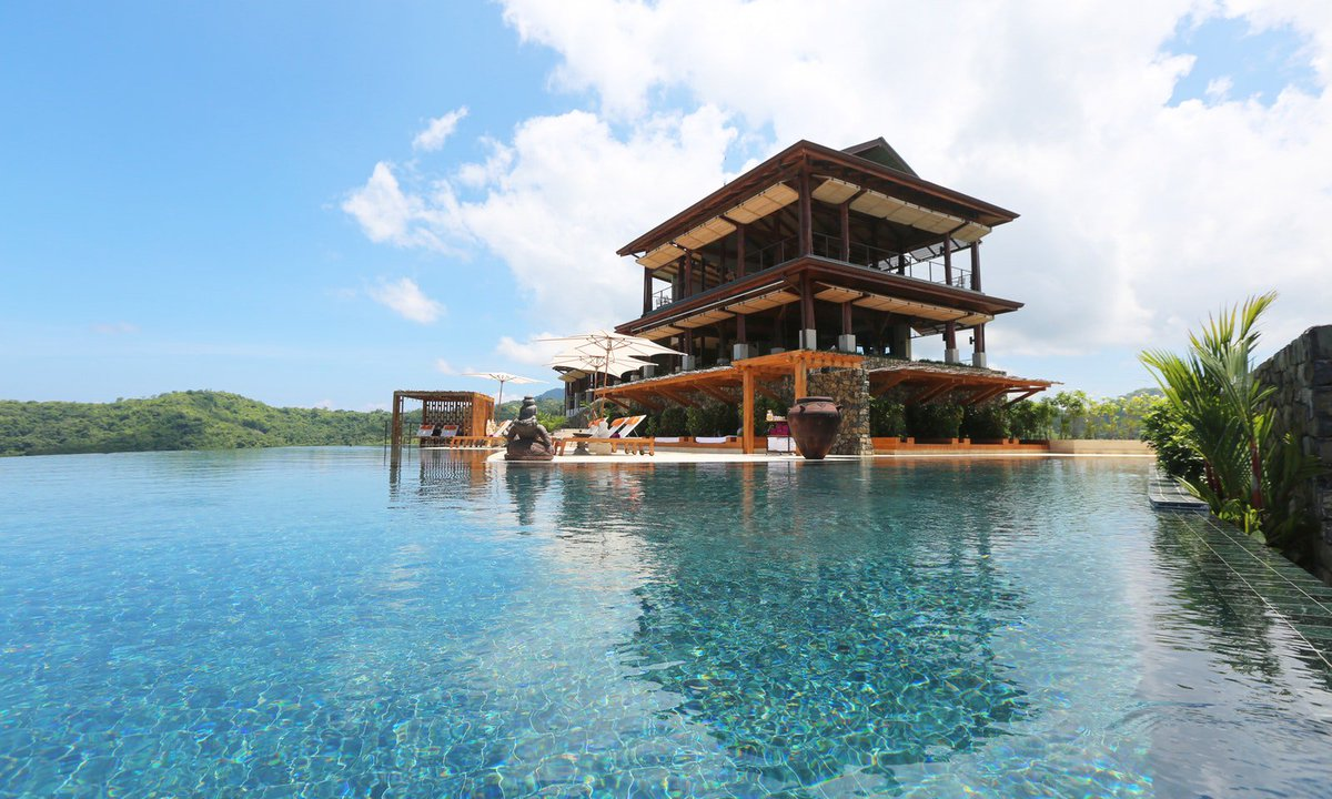 Plunge into aquamarine pool water when youre rested from yoga. This is Pura Vida in your next Costa Rican vacation #AnywhereVacation #CostaRica
