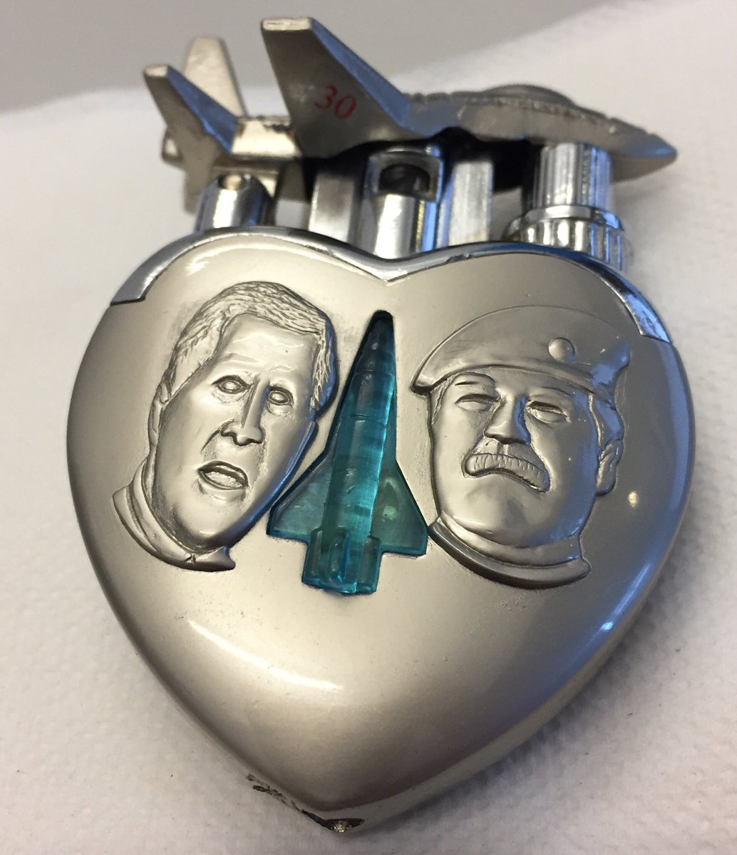 Olivier Knox On Twitter That Trump Kim Coin Reminds Me Of My Best Souvenir Ever This Heart Shaped Lighter With GWB And Saddam The Fighter Clicks Up