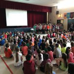 """The gym is filled with excitement as the Sward chorus sings """"Can't Stop this Reading"""" to reveal our One Book, One School title for the summer... """"The One and Only Ivan"""" by @kaaauthor We are looking forward to sharing conversations and activities about such a great book! #swd123"""