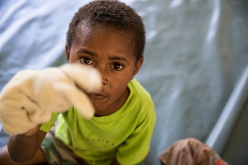 Six-year-old Stanford loves playing with puppets at a UNICEF supported Child Friendly Safe Space in Mendi, Southern Highlands Province, Papua New Guinea. #unicefpng #earthquakevictims #everychildhappy