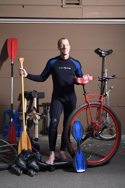 Bruce Dawson in wet suit with commute methods, copyright 2018 425 Business Magazine