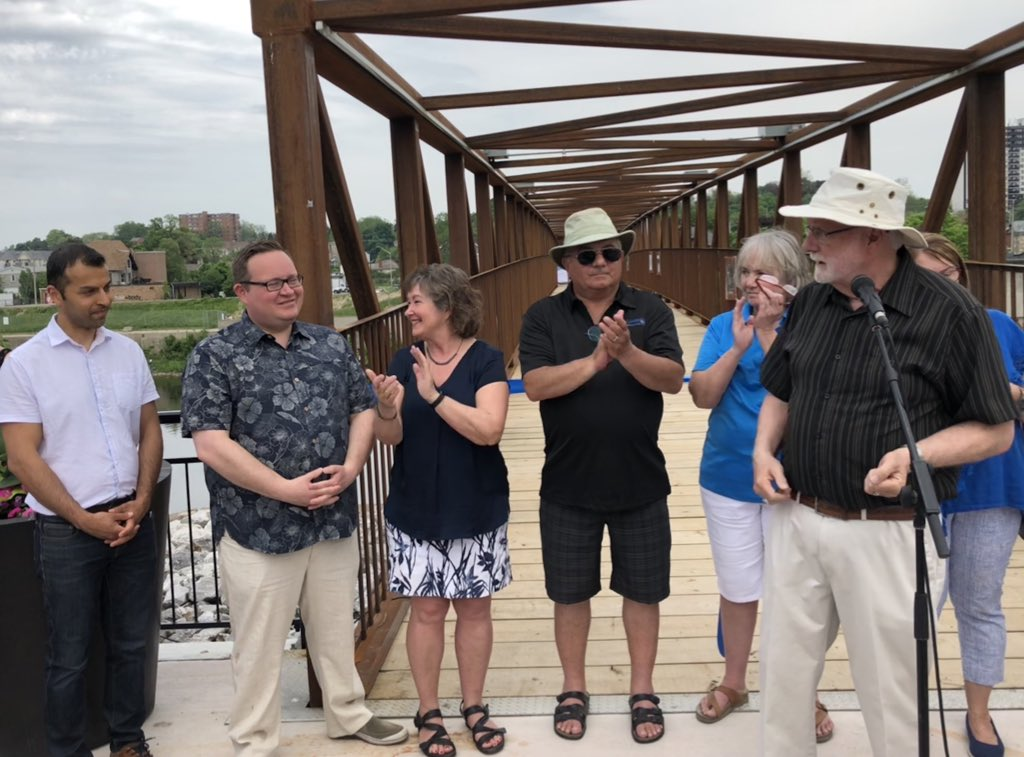 Grand opening of a beautiful new pedestrian bridge in Cambridge. It provides access across the Grand River to both Founder's Point and the Cambridge Sculpture Garden. Infrastructure like this builds connections in our community and brings us closer to our neighbors. <br>http://pic.twitter.com/ocwbuWEIGY