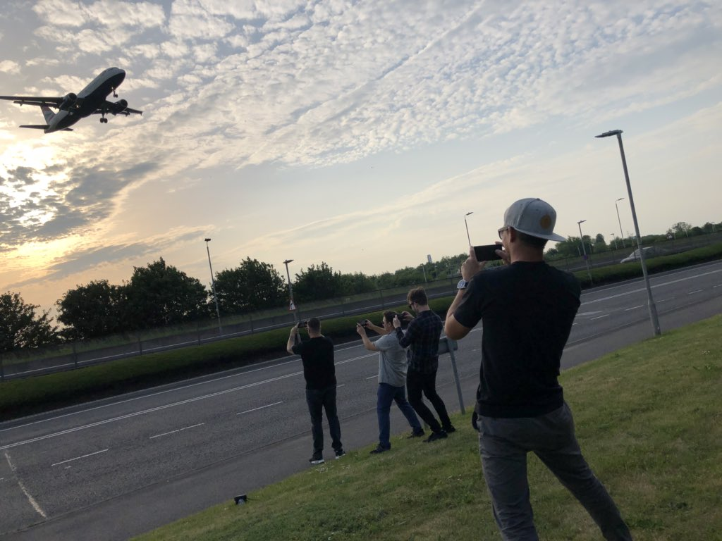 I took a pic of Tony taking a pic of Dan taking a pic of Kenny taking a pic of Zack taking a pic of a plane.