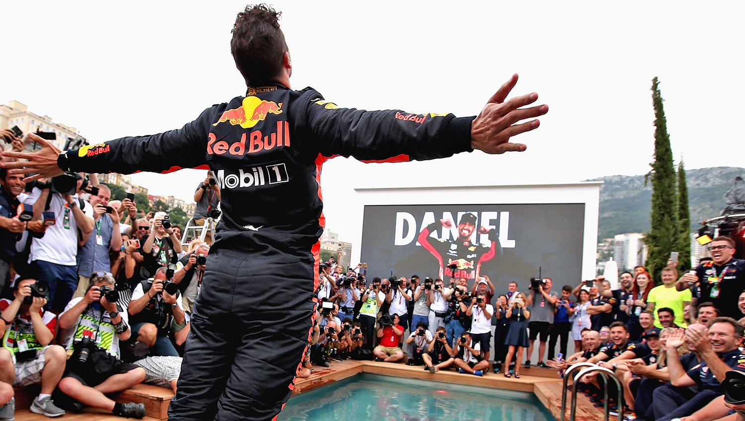 Daniel jumps in the pool following victory at the Monaco Grand Prix.