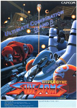 VトリガーIの「サイドアーム」は、1986年のカプコンのシューティングゲームのタイトルでもある。多くのストリートファイターシリーズを世に送り出した船水紀孝氏や安田朗氏の作品だ。 80年代のアーケードゲーマー向けのネタだ。