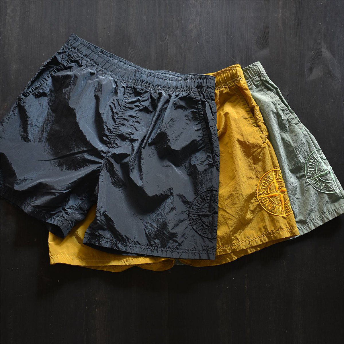 2efc423d57 Stone Island Nylon Logo Swim Shorts featuring tonal logo embroidery,  elasticated drawstring waist, mesh lining, 2 side pockets and back pocket  with zip ...